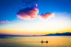 Fishing Boat with fisherman at Sunset on Koh Samui Royalty Free Stock Photo