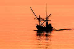 Fishing boat. The fishermen are on the coast in the morning after returning from fishing Stock Photography