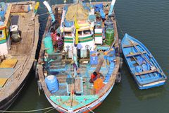 Fishing boat with fishing net, diesel tanks, cooking material in backwater, Anjarle, Kokan stock photos