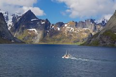 Fishing boat in fjord Royalty Free Stock Image