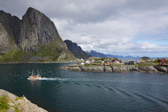 Fishing boat in fjord Stock Photo