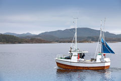 Fishing boat in fjord of Norway Stock Photography