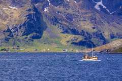Fishing boat in fjord Royalty Free Stock Photo