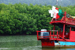 Fishing boat float to village port and mountain which is way to Royalty Free Stock Image