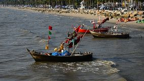 Fishing boat floating beside beach, Bangsaen, Thailand stock video footage