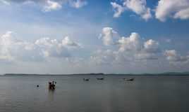 Fishing boat floating in the middle of the sea to make a living. Fishing boat floating in the middle of the sea to make a living at Laem Sai, Trang Province Stock Photography