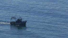 Fishing Boat Floating on the Ocean Waves stock video footage