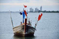 Fishing boat floating in a sea Stock Image