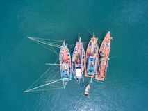 Fishing boat floating in the sea. The beautiful bright blue wate. R in a clear day Stock Image