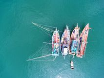 Fishing boat floating in the sea. The beautiful bright blue wate. R in a clear day Stock Photo