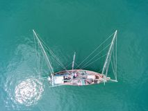 Fishing boat floating in the sea. The beautiful bright blue wate. R in a clear day Royalty Free Stock Photography