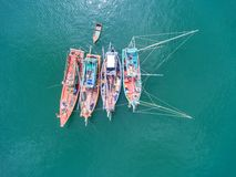 Fishing boat floating in the sea. The beautiful bright blue wate. R in a clear day Royalty Free Stock Image