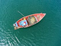 Fishing boat floating in the sea. The beautiful bright blue wate. R in a clear day Stock Photos