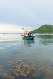 Fishing boat floating on the sea Stock Photos