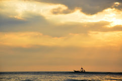 Fishing boat floating on the sea Stock Photography