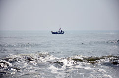 Fishing boat floating on the sea Stock Photo