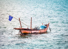 Fishing boat floating in the sea Royalty Free Stock Image