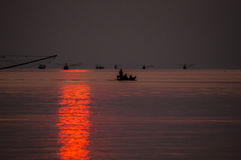 Fishing Boat floating in Sea at Sunrise. Chumporn, Thailand Royalty Free Stock Photo