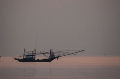 Fishing Boat floating in Sea at Sunrise. Chumporn, Thailand Stock Photography