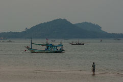 Fishing Boat floating in Sea at Sunrise. Chumporn, Thailand Stock Image