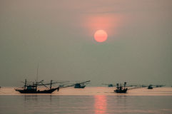 Fishing Boat floating in Sea at Sunrise. Chumporn, Thailand Royalty Free Stock Image