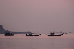 Fishing Boat floating in Sea at Sunrise. Silhouette shot, Chumporn, Thailand Stock Image