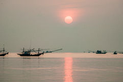 Fishing Boat floating in Sea at Sunrise. Silhouette shot, Chumporn, Thailand Royalty Free Stock Image