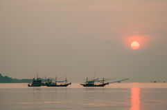 Fishing Boat floating in Sea at Sunrise. Silhouette shot, Chumporn, Thailand Stock Photography