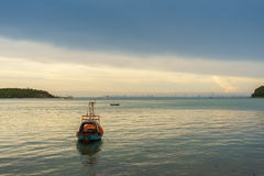 Fishing boat floating on the sea Royalty Free Stock Photo