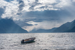 Fishing boat floating on water on fjord Stock Image