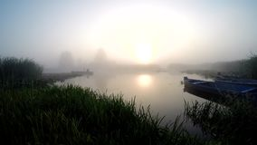 Fishing boat in the fog. Angler on a boat in the fog on a forest lake stock video