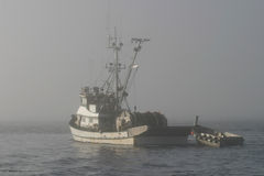 Fishing Boat In Fog Stock Images