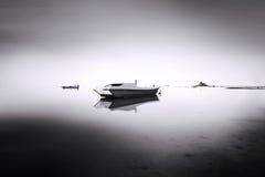 Boat in the fog. Beautiful sunset and coastal at Labuan island stock image