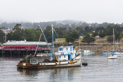 Fishing boat in a foggy Monterey Bay Royalty Free Stock Photo