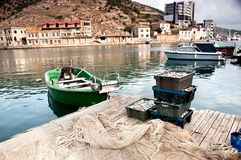 Fishing boat and freshly caught fish in fish crates. Royalty Free Stock Images