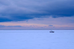 Fishing boat frozen in the ice Stock Photography
