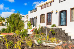 Fishing boat in garden of typical Canarian houses Stock Photo