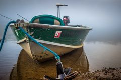 Chattahoochee Fishing Vessel. A fishing boat is getting ready to be launched at the Chattahoochee river on a foggy morning stock photos