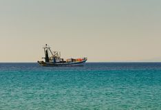 Fishing boat goes to fish Stock Photo