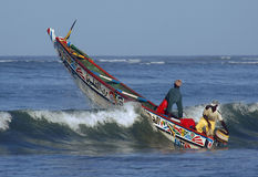 Fishing boat going over a wave Royalty Free Stock Image