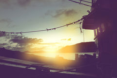 fishing boat is going to shore in sunset Royalty Free Stock Image