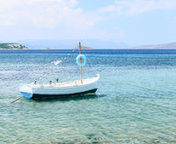 White fishing boat. Fishing boat with a Greek flag Royalty Free Stock Images