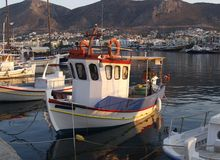 Fishing boat in greek harbour Stock Photos