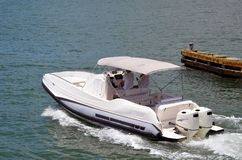 Fishing Boat With Grey Canvas Canopy and Two Outboard Engines. On the florida intra-coastal waterway off Miami Beach Stock Photography