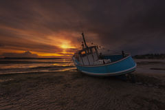 Fishing Boat grounded at low tide in Poole Harbour Royalty Free Stock Images