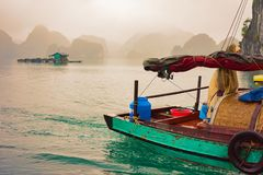 Fishing boat on Ha Long Bay Vietnam at sunset Asia. Fishing boat on Ha Long Bay, Vietnam, Asia, at sunset. Limestone islands on the background royalty free stock images