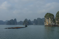 Fishing boat in Ha Long bay, Vietnam. Cloudy winter weather Royalty Free Stock Photography
