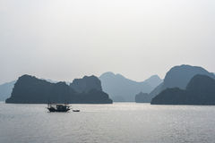 Fishing boat on Halong bay. Vietnam Stock Photo