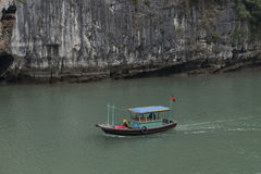 Fishing boat in Halong Bay, Vietnam. Fishing boat sailing in Halong Bay, Vietnam royalty free stock image