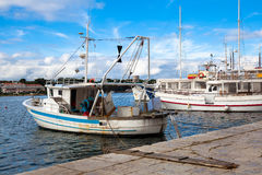 Fishing boat in harbor Stock Image